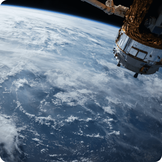 Earth with a sattelite in the outer space